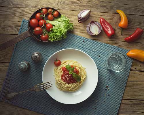 vegetable spaghetti on white ceramic plate produce