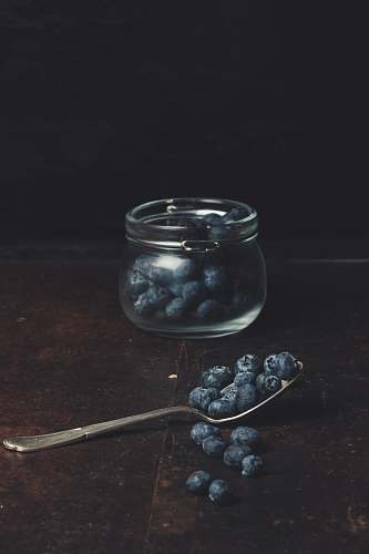 fruit spoonful of blueberries from glass jar blueberry