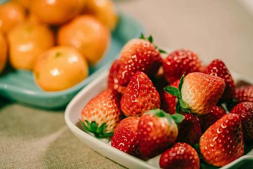 fruit strawberry and orange fruits in bowl plant