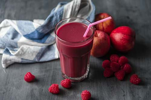 fruit strawberry juice beside strawberry fruits raspberry