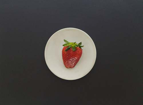 fruit strawberry on white saucer plant