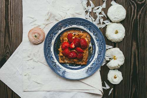 toast strawberry serve on blue plate flowers