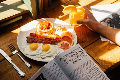 breakfast sunny-side up served on plate human