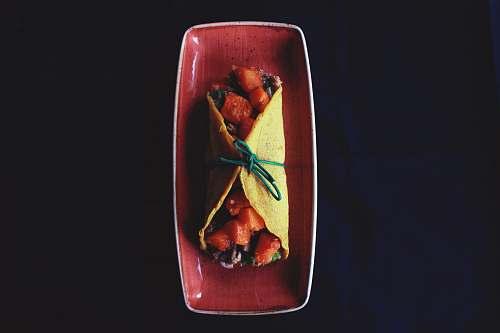 dish taco on maroon ceramic tray meal
