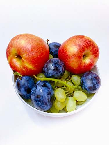 plant three assorted fruits in bowl apple