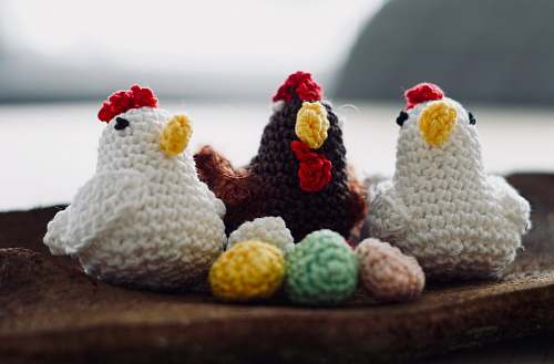 confectionery three knit chicken figures on brown wood sweets