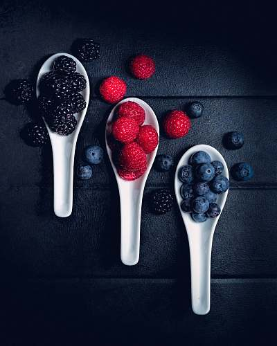 plant three ladles of berries on gray surface fruit