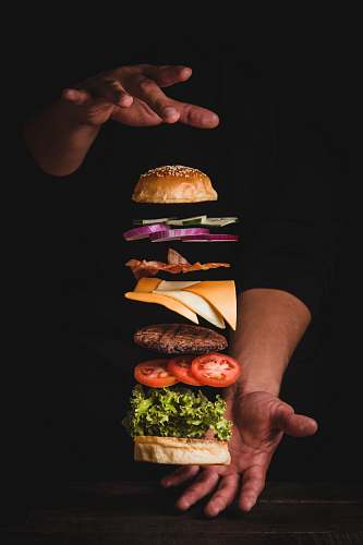 photo burger timelapse photo of man holding burger human free for commercial use images