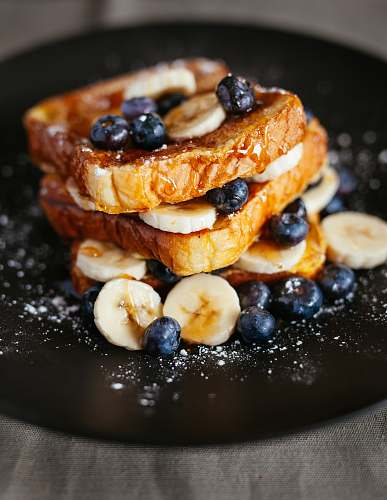 french toast toast bread with blueberry on black plate blueberry