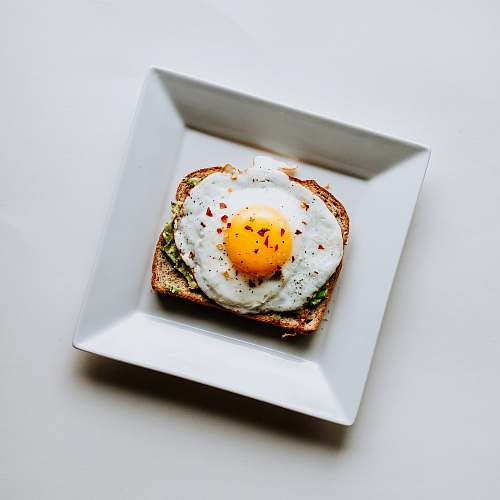 meal toasted wheat bread with fried egg breakfast