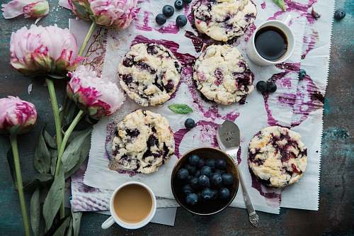flower top view photography of blueberry cakes peony