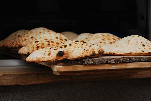 bread tray of food on wooden surface pita