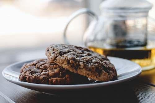 cookies two cookies on white ceramic plate tea
