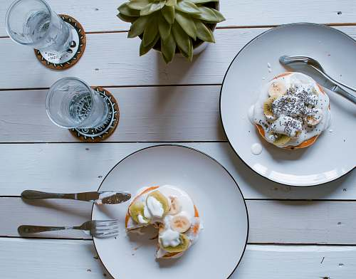 cutlery two donuts on plate spoon