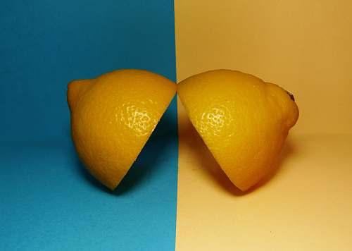 fruit two sliced lemons on surface citrus fruit