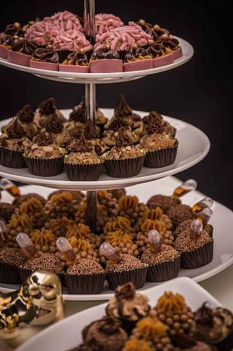 cake variety of cupcakes on cupcake rack cream