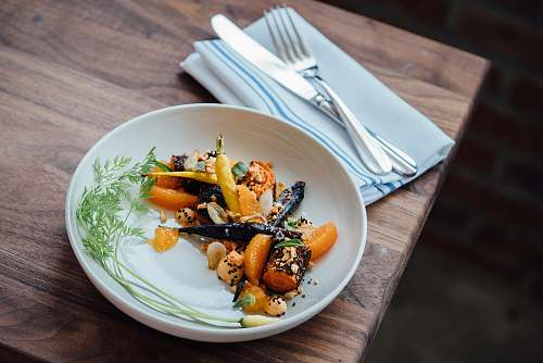 carrots vegetable dish on white plate meal