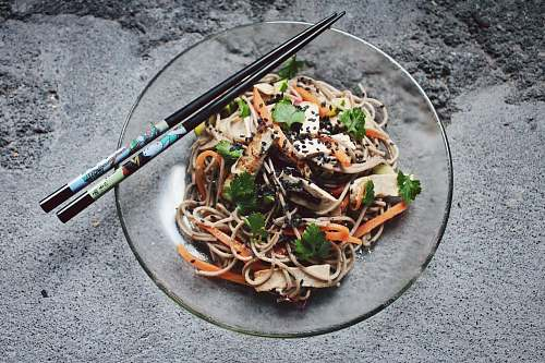 noodle vegetable noodle with chopstick on glass plate pasta