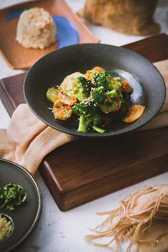 plant vegetable salad served on black ceramic plate broccoli