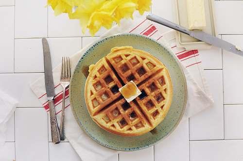 waffle waffle on gray ceramic plate syrup