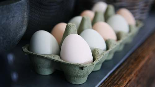 egg white and beige eggs on tray eggs