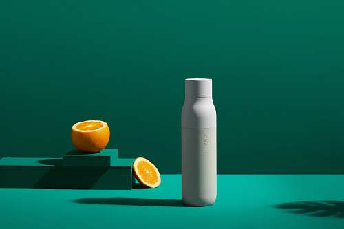 fruit white bottle near orange slice plant