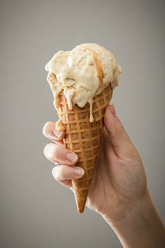 cream white ice cream on brown cone dessert