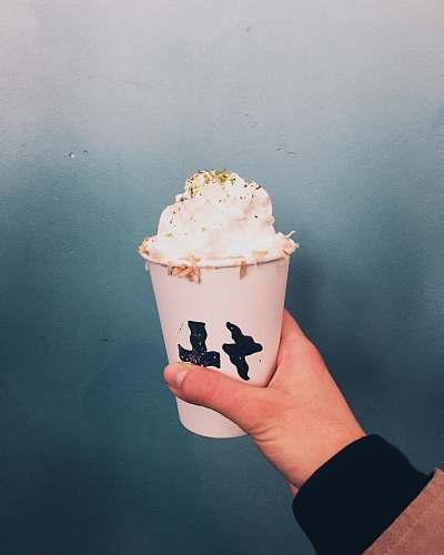 dessert white ice cream on cup person