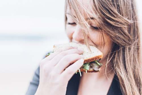 people woman eating sandwich sandwich