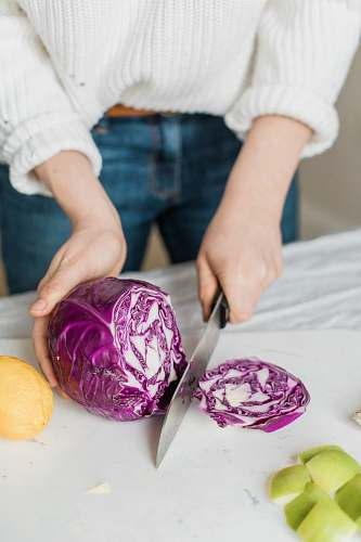 plant woman slicing purple vegetable person
