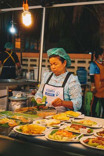 meal woman standing near food human