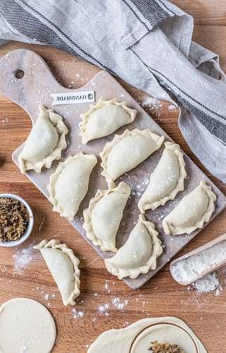 ravioli wrapped foods on tray pasta