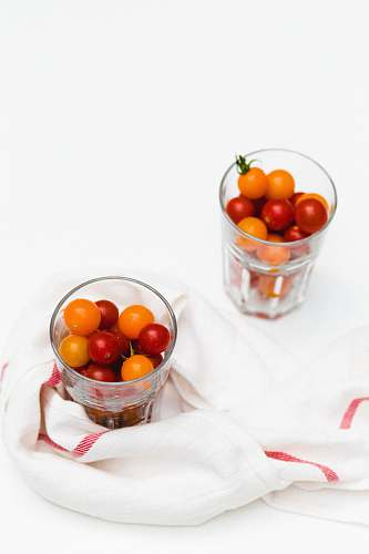 vegetable yellow and red tomatoes in glasses tomato