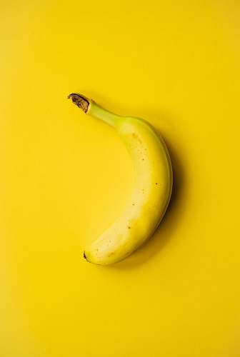 fruit yellow banana fruit on yellow surface banana