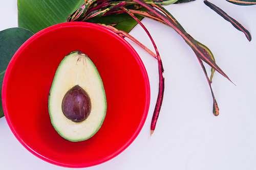 food guacamole in red bowl avocado