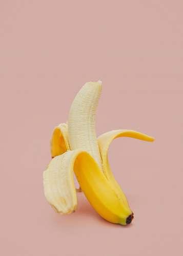 food half peeled banana fruit banana