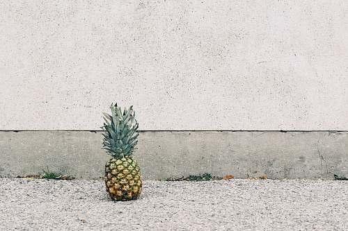pineapple pineapple fruit beside wall food