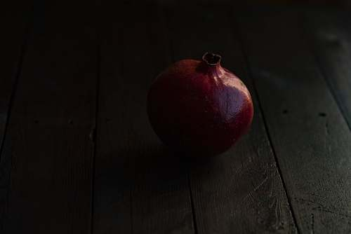 food red pomegranate fruit on brown wooden surface apple