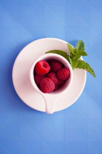 food red raspberries on mug plant