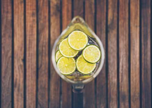 plant sliced lime in clear glass pitcher citrus fruit