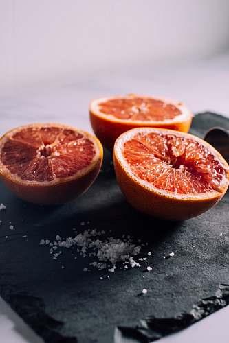 produce sliced orange fruits grapefruit