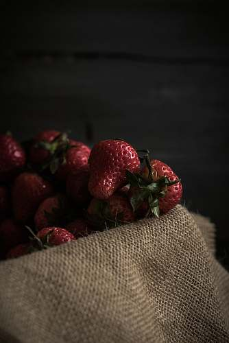 food strawberries on brown textile plant