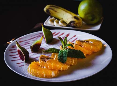 food sushi dish with mint citrus fruit