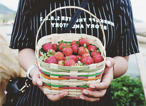 food woman holding basket of strawberries strawberry