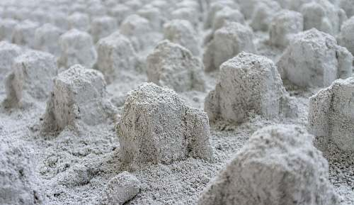 flour macro photography of stone formations powder