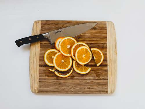 weaponry sliced oranges on chopping board weapon