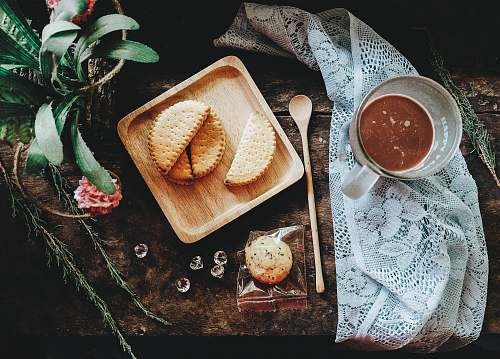 food flat-lay photography of pastry on tray beside glass mug breakfast
