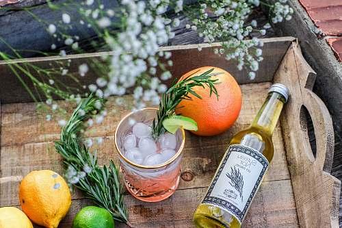 fruit orange fruit beside bottle of drink citrus fruit