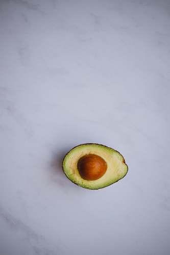 food photo of avocado on white surface avocado