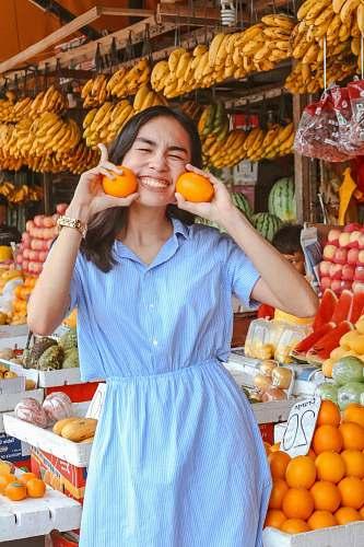food woman in blue dress fruit